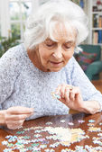 Senior Woman Relaxing With Jigsaw Puzzle At Home — Stock Photo