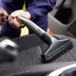 Man Hoovering Seat Of Car During Car Cleaning — Stock Photo #76541449