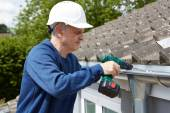 Workman Replacing Guttering On Exterior Of House — Stock Photo