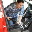 Woman Cleaning Inside Of Car Using Vacuum Cleaner — Stock Photo #77140261