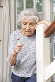 Unwell Senior Woman Using Personal Alarm At Home — Stock Photo