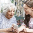 Teenage Granddaughter Showing Grandmother How To Use Mobile Phon — Stock Photo #83029510