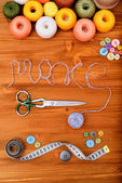 "Word ""make"" with sewing tools and accesories on wooden background — Stock Photo"