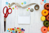 Copyspace frame with sewing tools and accesories on white wooden background — Stock Photo