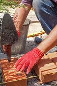 Bricklayer with brick — Stock Photo