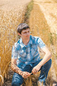 Man on wheat field — Stock Photo