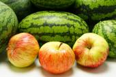 Apples on a background of watermelons. — Stock Photo