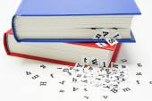 Letters falling from the blue book. — Stock Photo