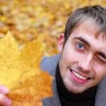Autumn. the man. smile. park — Stock Photo #61792615