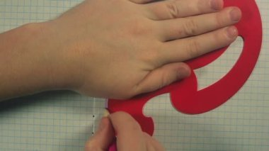 The childs hand draws the curved line — Stock Video