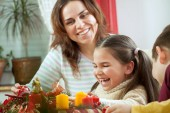 Happy young family getting ready for the Advent, Christmas holid — Stock Photo