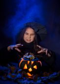 The little witch with halloween pumpkin — Stock Photo