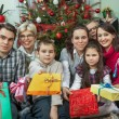 Portrait of happy multigeneration family with Christmas gifts si — Stock Photo #56696691