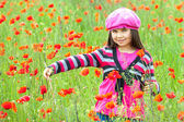 Vintage little girl on the poppy meadow — Stock Photo