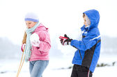Happy family enjoying in winter — Stockfoto