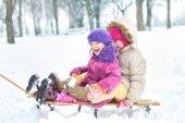 Happy family enjoying in winter — Stock Photo