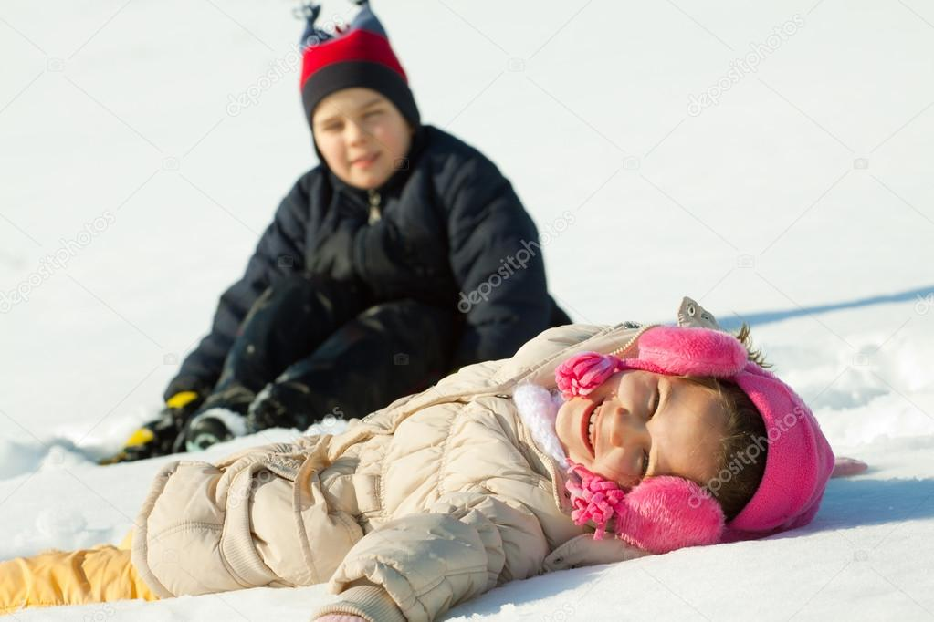 Kids Laughing And Playing Happy Children in Winterwear Laughing While Playing in Snowdrift Outside