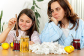 Mother and daughter with cold or flu — Stock Photo