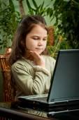 Cute little girl learning on her laptop — 图库照片
