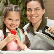 Mother ironing with little daughter — Stock Photo #58812857