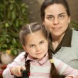 Mother ironing with little daughter — Stock Photo #58812971