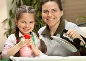 Mother ironing with little daughter — Stock Photo