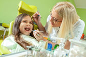 Little girl sitting in the dentists office — Stock Photo