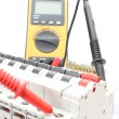 Electric switch on the control panel and multimeter — Stock Photo