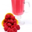Fresh raspberries pouring out of yellow bowl and fresh cocktail — Stock Photo #52277865