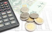 Heap of coins, paper money and calculator on spreadsheet — Stock Photo