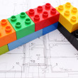 Wall of colorful building blocks on housing plan — Stock Photo #53959791
