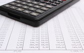Closeup of spreadsheet with calculator — Foto de Stock