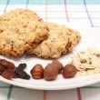 Oatmeal cookies with ingredients on white plate — Stock Photo #55789407