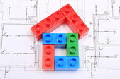 House of colorful building blocks on drawing of home — Foto de Stock