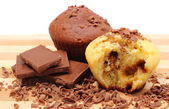 Fresh baked muffins, grated and portion of chocolate — Stock Photo