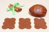 Gingerbread dough for Christmas cookies and cinnamon sticks — Stock Photo