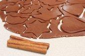 Cinnamon sticks and dough for Christmas cookies — Stock Photo