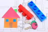 Home of colored paper, keys and building blocks on drawing of house — Stock Photo