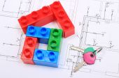 House of colorful building blocks, keys on drawing of home — Stock Photo