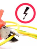 Metal pliers, green yellow cable and high voltage danger sign — Stock Photo