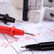 Cables of multimeter pen and electric fuse on electrical drawing — Stock Photo #59418961