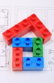 House of colorful building blocks on drawing of home — Stock Photo