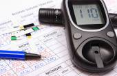 Glucometer and accessories for measurement on medical forms for diabetes — Stock Photo