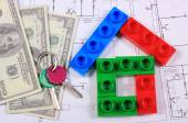 House of colorful building blocks, keys and banknotes on drawing — Stock Photo