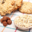 Oatmeal cookies with ingredients lying on colored background — Stock Photo #61201397