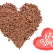 Heart shaped grated chocolate on white background — Stock Photo #61449855