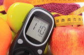 Glucose meter, fruits, tape measure, accessories for fitness — Stock Photo