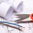 Accessories for engineer jobs and rolls of diagrams on construction drawing — Stock Photo #62278347