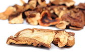 Heap of dried mushrooms on white background — Stock Photo
