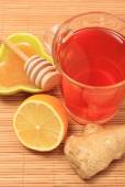 Cup of healthy tea with honey ginger and lemon on wooden background — Stock Photo